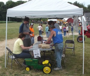 Members selling tickets for the tractor raffle and the dairy display raffle.